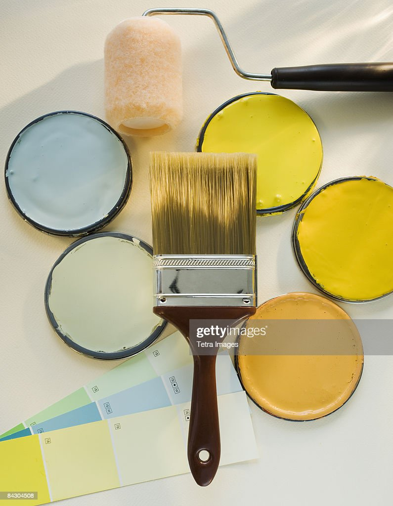 Paintbrushes and assorted paints : Stock Photo