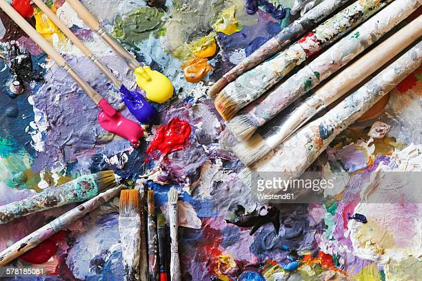 Paintbrushes and fresh paint on artists palette