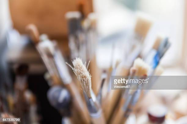 Paintbrushes in artists workshop