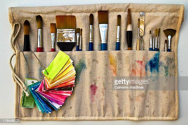 paintbrushes in cloth holder - catherine macbride stock pictures, royalty-free photos & images