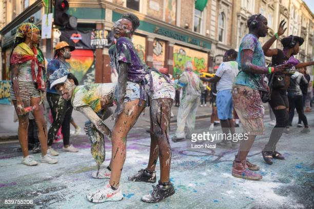 """Paint-covered revellers take part in the traditional """"J'ouvert"""" opening parade of the Notting Hill carnival on August 27, 2017 in London, England."""