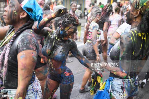Paintcovered revellers take part in the traditional 'J'ouvert' opening parade of the Notting Hill carnival on August 27 2017 in London England