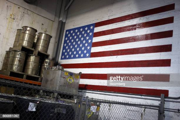A painted American flag is displayed on the wall inside a chemical storage area at the Rochester Silver Works LLC facility in Rochester New York US...