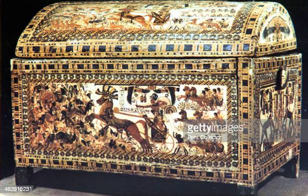Painted and inlaid coffer from the Treasure of Tutankhamun Ancient Egyptian c1325 BC A coffer decorated with a scene of a king in a war chariot from...