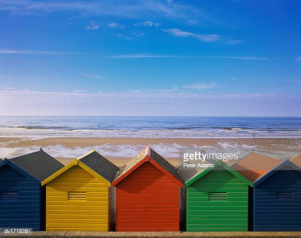 Painted Beach Huts in a Line, Whitby, England, UK