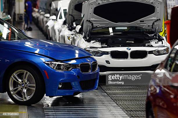 Painted BMW 3 Series automobiles pass along the production line during assembly at the Bayerische Motoren Werke AG plant in Rosslyn South Africa on...