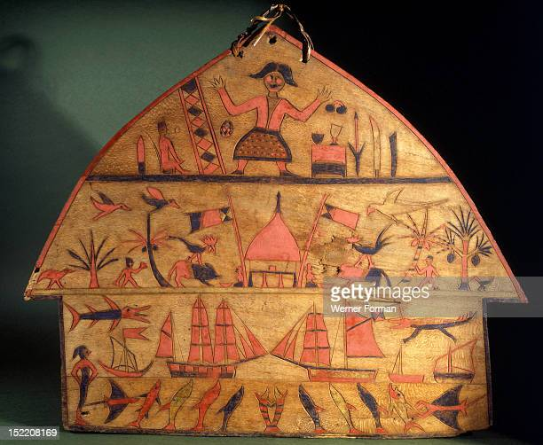 A painted board or henta Deuse the god of the white man is shown here surrounded by images of his omnipotence Decorated henta koi or shields such as...