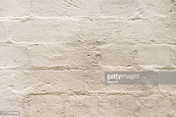 painted brick wall - cream colored stock pictures, royalty-free photos & images