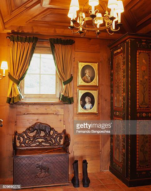 painted cabinet and wooden bench in room - fernando bengoechea stock pictures, royalty-free photos & images