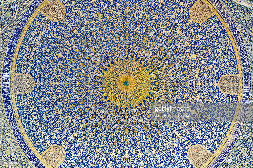 Painted ceramic tiles in dome of the Shah mosque in Esfahan, Iran : ストックフォト