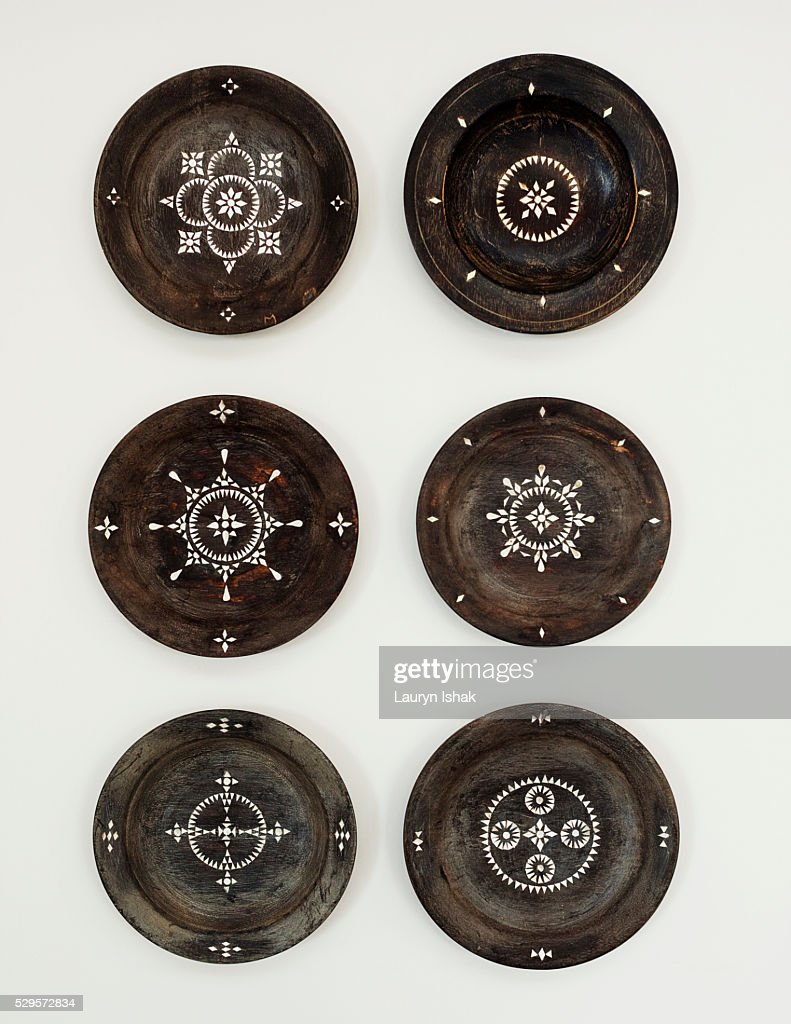 Painted decorative plates on wall : Stock Photo