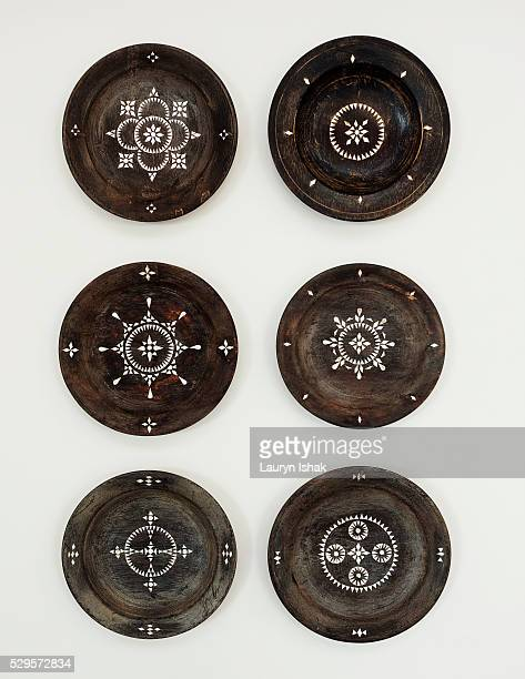 Painted decorative plates on wall