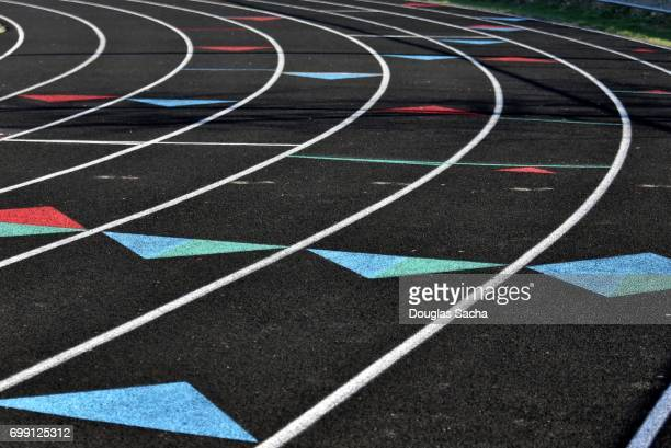 painted dividing lines for runners on the track and field turf - blacksburg stock pictures, royalty-free photos & images