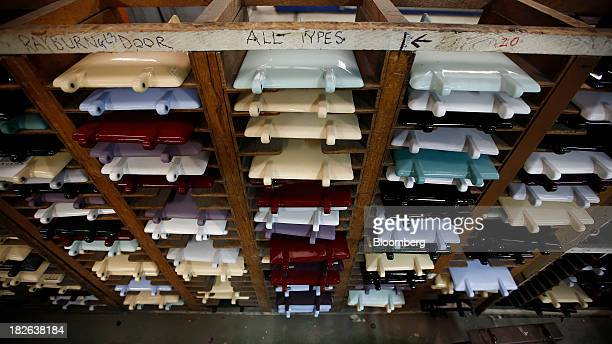 Painted doors for AGA and Rayburn range cookers produced by AGA Rangemaster Plc sit in storage racks ahead of assembly at the company's plant in...