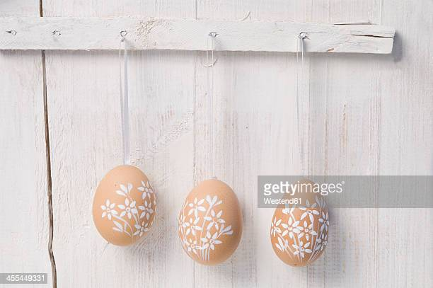 Painted easter eggs hanging on wall