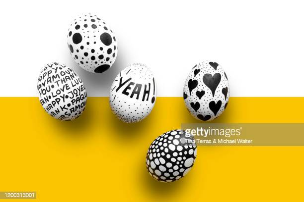 painted easter eggs on yellow and white background. flat lay. - happy easter text stock pictures, royalty-free photos & images