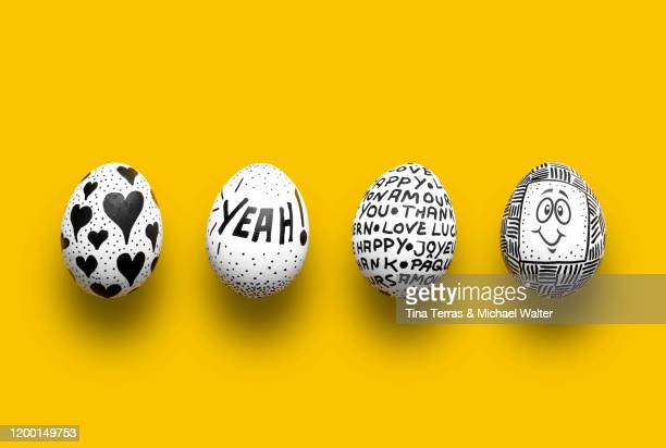 painted easter eggs on yellow background. flat lay. - easter stock pictures, royalty-free photos & images