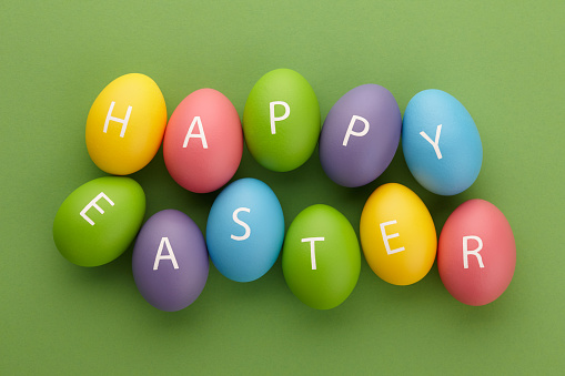 Painted eggs arranged in Happy Easter greeting 1138026513