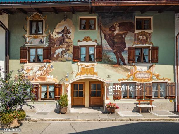 painted facade in mittenwald village germany - mittenwald stock pictures, royalty-free photos & images