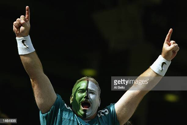 A painted fan of the Philadelphia Eagles goes crazy during the NFL game against the Houston Texans on September 29 2002 at Veterens Stadium in...