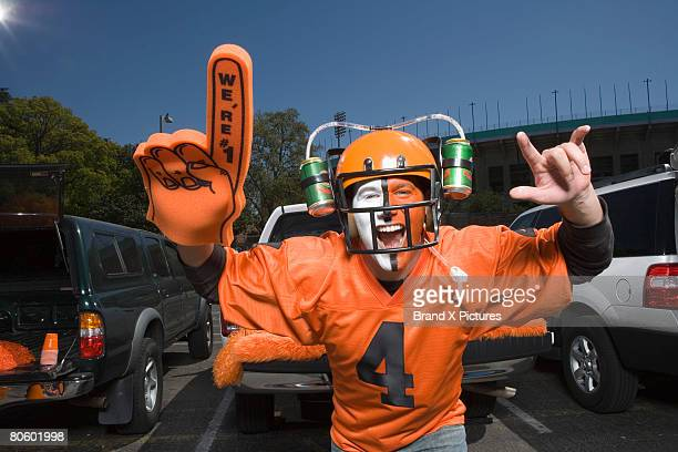painted fan with beer helmet - foam finger stock photos and pictures
