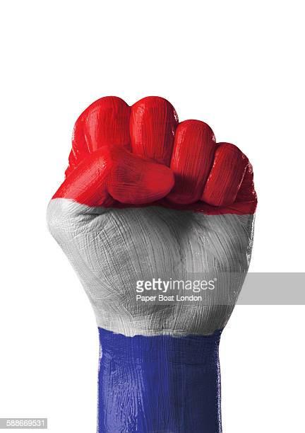 painted flag of netherlands on a hand - nederlandse vlag stockfoto's en -beelden