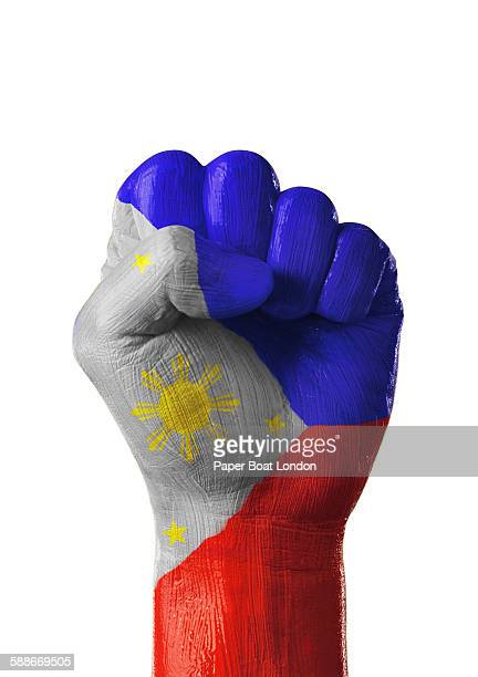 painted flag of philippines on a hand - philippines flag stock pictures, royalty-free photos & images