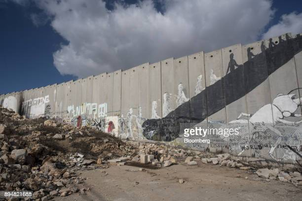 Painted graffiti murals sit on the Israeli West Bank security barrier wall in the Aida refugee camp in Bethlehem Israel on Friday Dec 15 2017 The...