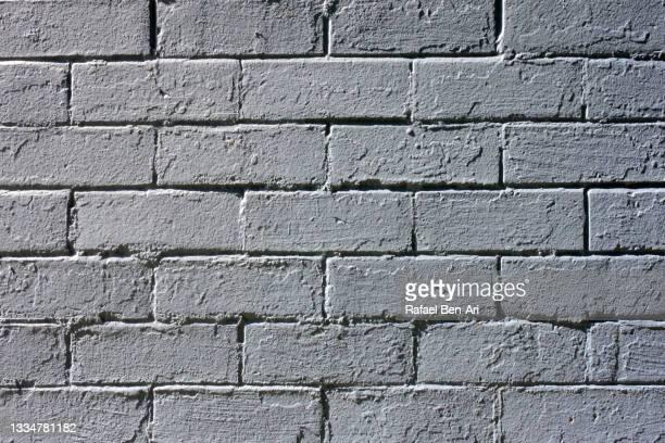 painted grey brick wall background - rafael ben ari imagens e fotografias de stock