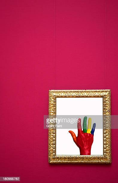 Painted hand photograph framed