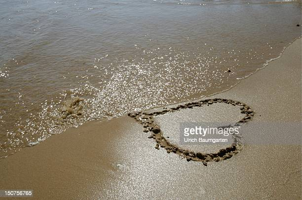 Painted heart in the sand