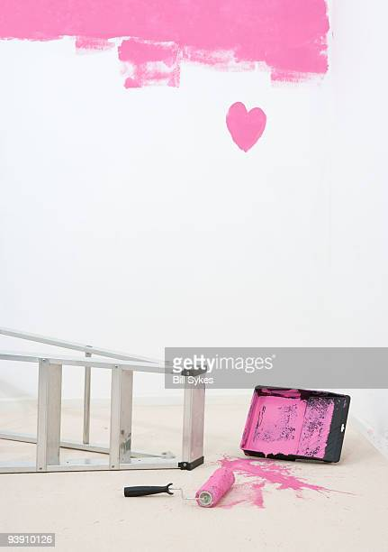 painted heart on wall and spilt paint