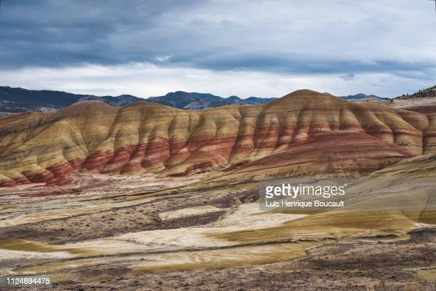 painted hills and clouds - john day fossil beds national park stock pictures, royalty-free photos & images