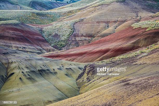 painted hills in greens and rust - painted hills stock pictures, royalty-free photos & images