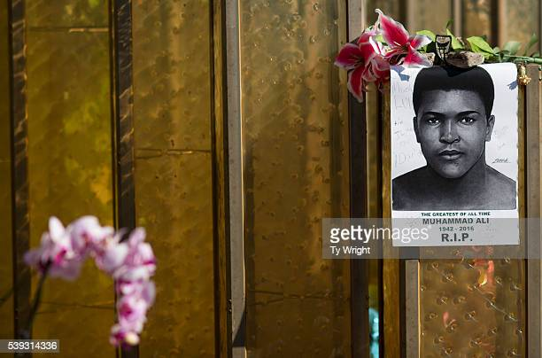 A painted image of Muhammad Ali is seen on a glass monument at the Muhammad Ali Center on June 10 2016 in Louisville Kentucky After the funeral and...