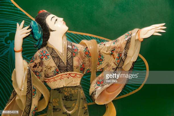 Painted jade carving of a Chinese woman on a piece of furniture Beijing China