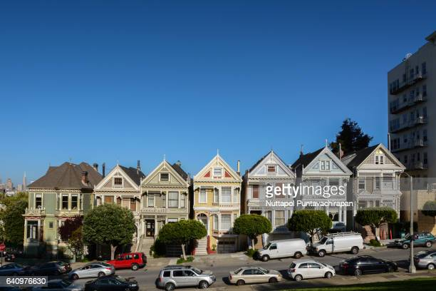 painted ladies, alamo square, california - side by side stock photos and pictures