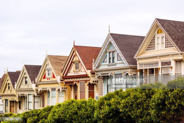 painted ladies houses at alamo square, san francisco, california, usa - american culture stock pictures, royalty-free photos & images