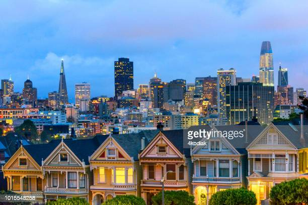 painted ladies houses in san francisco in evening hour - san francisco california stock photos and pictures