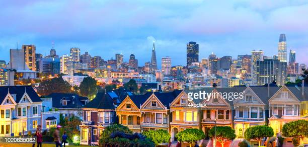 painted ladies houses in san francisco in the evening hour panorama - san francisco california stock photos and pictures