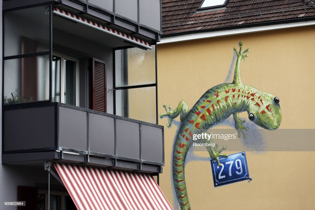 A painted lizard wall mural stands on the exterior of a residential apartment block in Bern, Switzerland, on Wednesday, Jan. 3, 2018. The supply of uninhabited apartments for rent has increased faster than the Swiss population has grown. Photographer: Stefan Wermuth/Bloomberg via Getty Images