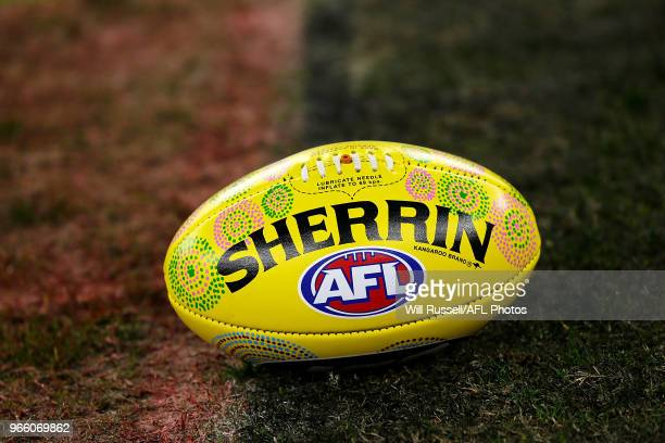 A painted match ball for the Indigenous round can be seen during the round 11 AFL match between the West Coast Eagles and the St Kilda Saints at...