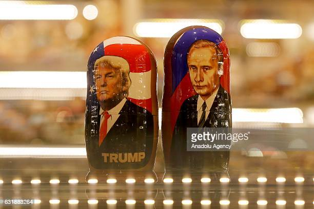 Painted Matryoshka dolls or known as Russian nesting dolls bearing the faces of Russian President Vladimir Putin and Presidentelect Donald Trump are...