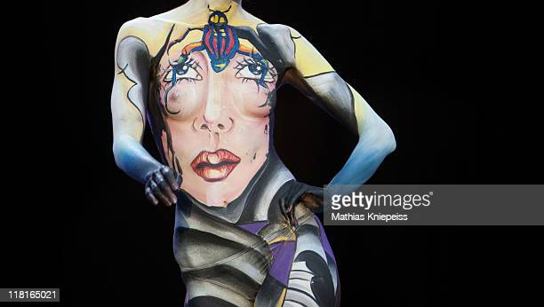 A painted model poses for photographers on the final day at the World Bodypainting Festival 2011 on July 3 2011 in Poertschach Austria The festival...