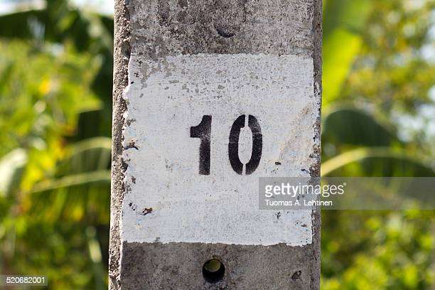 Painted number ten on a concrete column outdoors
