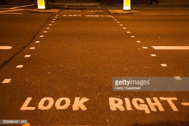 """""""look right"""" painted on street - henry street stock pictures, royalty-free photos & images"""