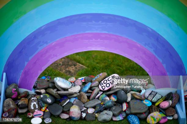 Painted pebbles from Llandudno beach, in honour of the NHS, sit outside Venue Cymru Nightingale Hospital on October 29, 2020 in Llandudno, Wales. In...