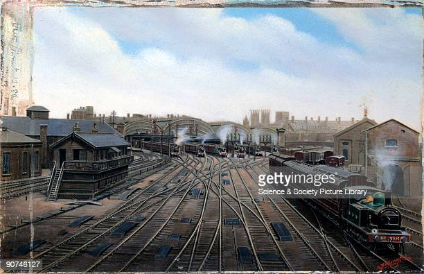 Painted photograph by F Moore showing the south end of York station a signalbox and trains about to depart York station was designed by the North...