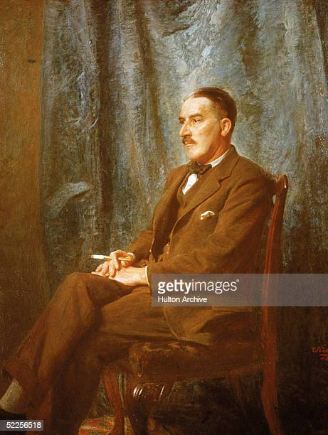 Painted portrait of British archaeologist discoverer of Pharaoh Tutankhamen's tomb Howard Carter as he sits in a chair and holds a cigarette early...