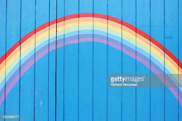painted rainbow on wooden fence - rainbow stock pictures, royalty-free photos & images
